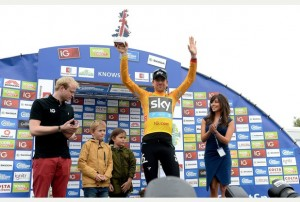 Sir Bradley Wiggins celebrates after taking the lead in The Tour of Britain and the gold jersey, during the Stage Three Individual Time Trial in the 2013 Tour of Britain in Knowsley.